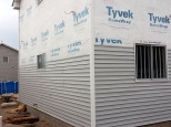 Siding going up